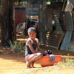 Girl washing clothes in Maputo, Mozambique