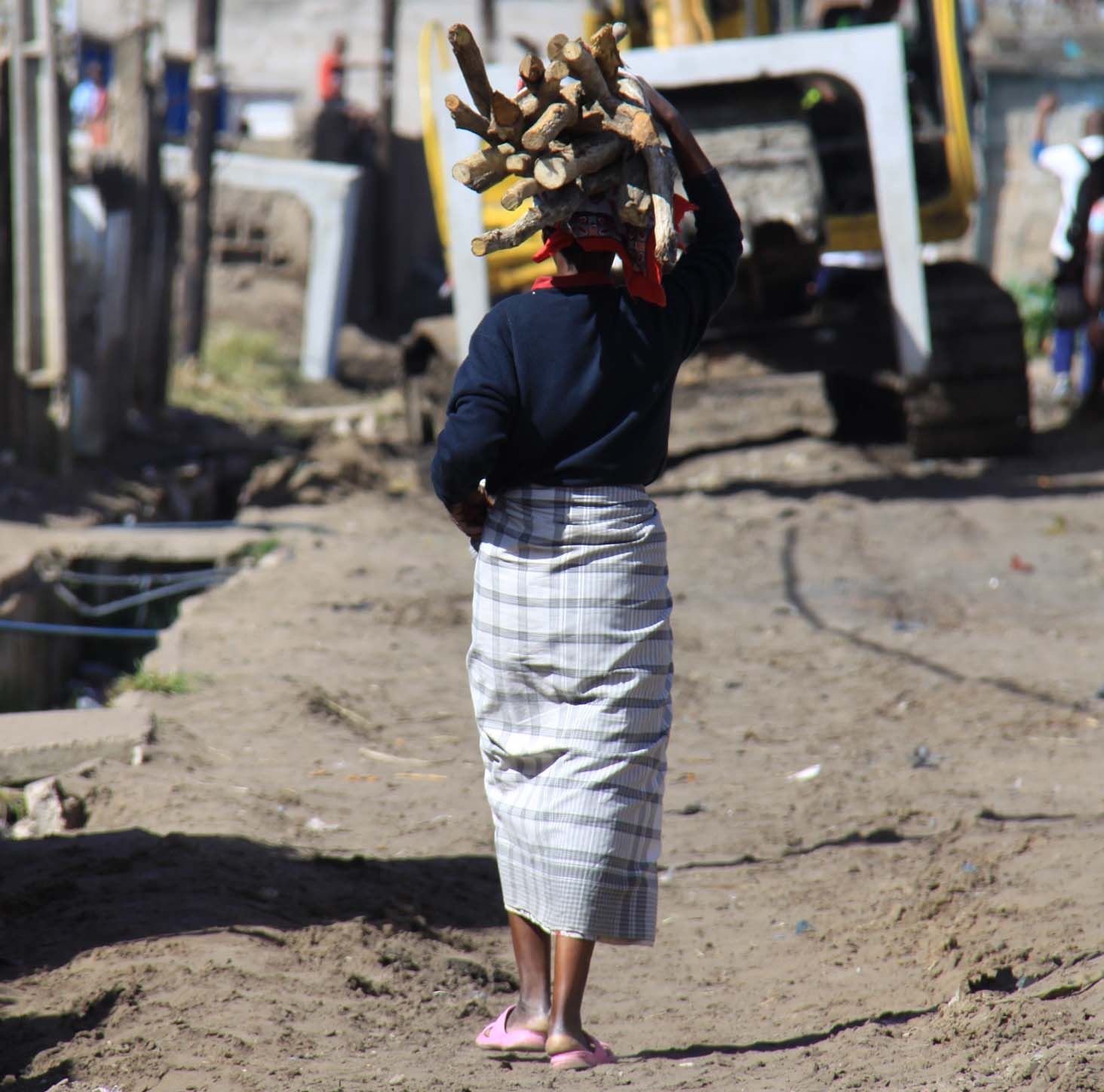 Woman carrying firewood, Maputo